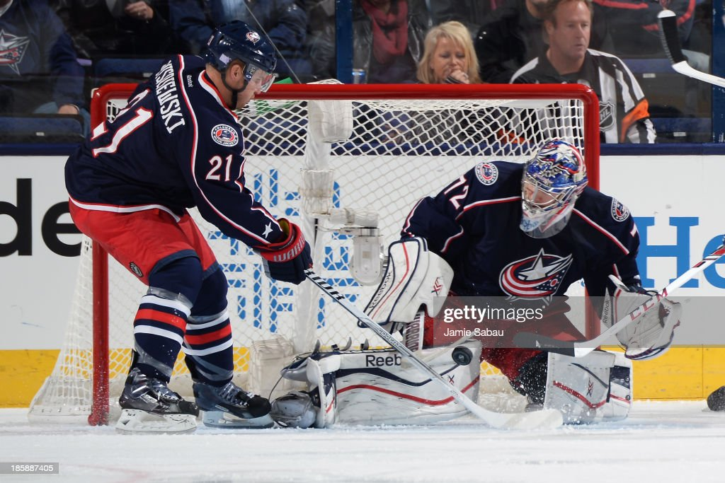 Goaltender <a gi-track='captionPersonalityLinkClicked' href=/galleries/search?phrase=Sergei+Bobrovsky&family=editorial&specificpeople=4488556 ng-click='$event.stopPropagation()'>Sergei Bobrovsky</a> #72 of the Columbus Blue Jackets follows a loose puck during the first period on October 25, 2013 at Nationwide Arena in Columbus, Ohio.