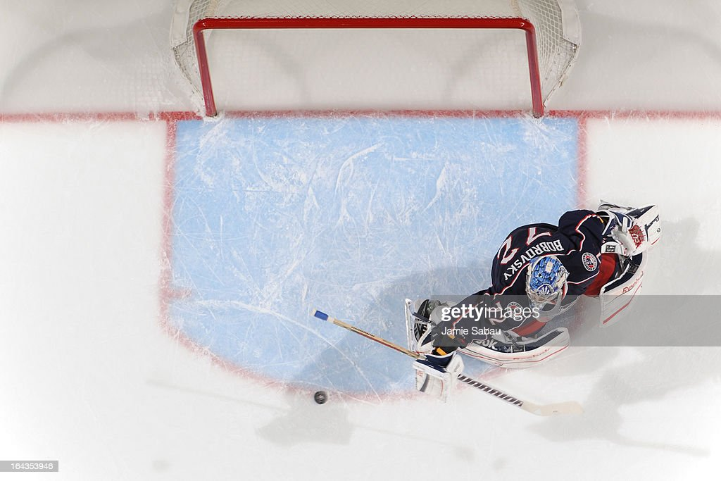 Goaltender <a gi-track='captionPersonalityLinkClicked' href=/galleries/search?phrase=Sergei+Bobrovsky&family=editorial&specificpeople=4488556 ng-click='$event.stopPropagation()'>Sergei Bobrovsky</a> #72 of the Columbus Blue Jackets follows the puck in a game against the Calgary Flames on March 22, 2013 at Nationwide Arena in Columbus, Ohio. Columbus defeated Calgary 5-1.