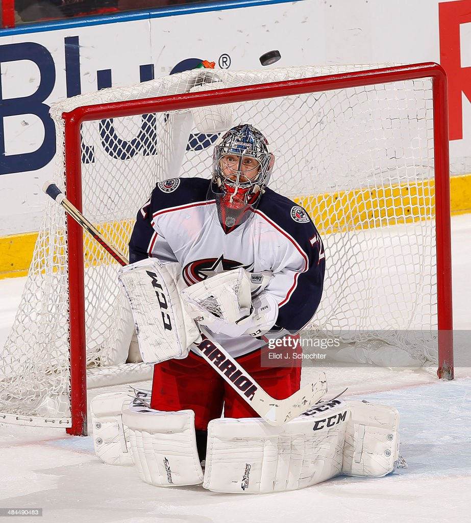 Goaltender <a gi-track='captionPersonalityLinkClicked' href=/galleries/search?phrase=Sergei+Bobrovsky&family=editorial&specificpeople=4488556 ng-click='$event.stopPropagation()'>Sergei Bobrovsky</a> #72 of the Columbus Blue Jackets keeps his eyes on a flying puck against the Florida Panthers at the BB&T Center on April 12, 2014 in Sunrise, Florida.