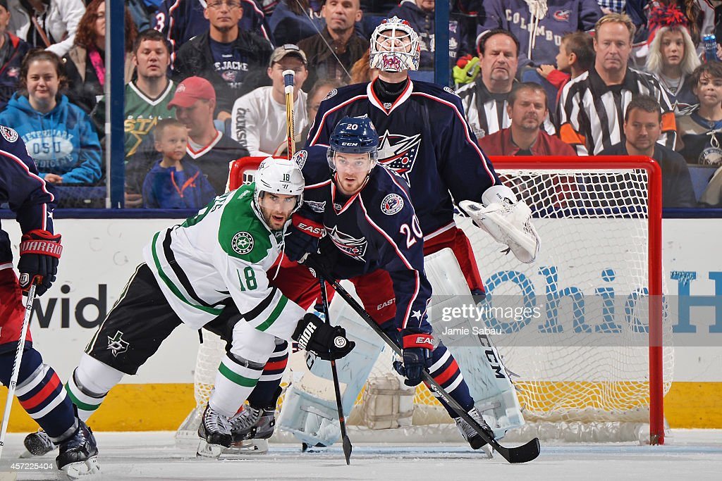 Goaltender Sergei Bobrovsky #72 of the Columbus Blue Jackets looks over Patrick Eaves #18 of the Dallas Stars and Tim Erixon #20 of the Columbus Blue Jackets as they battle for position during the third period on October 14, 2014 at Nationwide Arena in Columbus, Ohio. Dallas defeated Columbus 4-2.