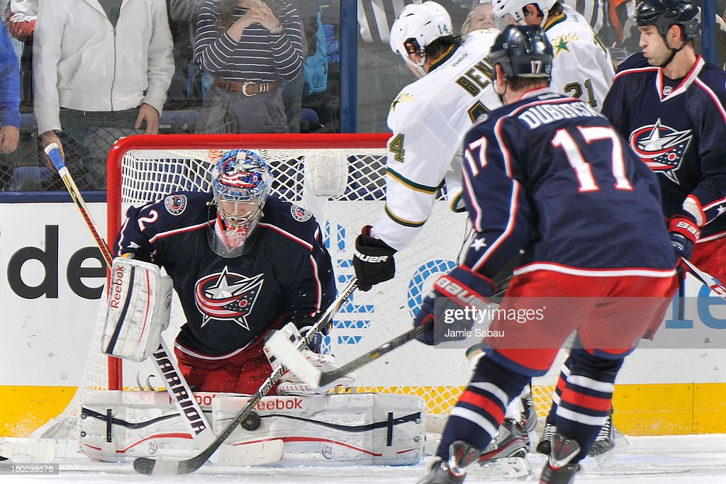 Goaltender <a gi-track='captionPersonalityLinkClicked' href=/galleries/search?phrase=Sergei+Bobrovsky&family=editorial&specificpeople=4488556 ng-click='$event.stopPropagation()'>Sergei Bobrovsky</a> #72 of the Columbus Blue Jackets makes a pad save as #14 of the Columbus Blue Jackets looks for the rebound in the third period on January 28, 2013 at Nationwide Arena in Columbus, Ohio. Columbus defeated Dallas 2-1.
