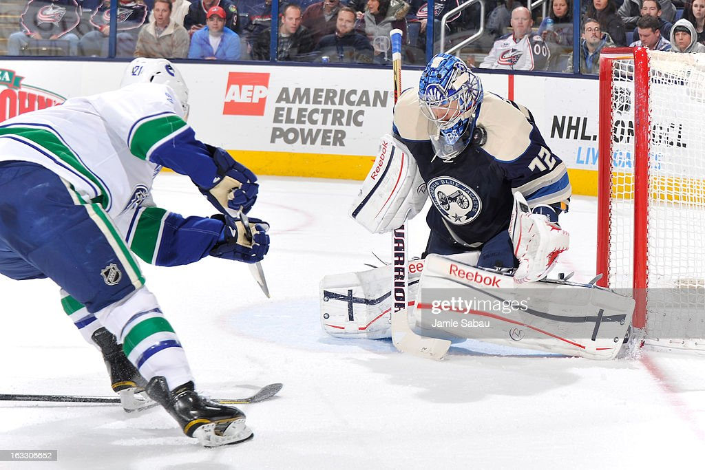 Goaltender <a gi-track='captionPersonalityLinkClicked' href=/galleries/search?phrase=Sergei+Bobrovsky&family=editorial&specificpeople=4488556 ng-click='$event.stopPropagation()'>Sergei Bobrovsky</a> #72 of the Columbus Blue Jackets makes a save against the Vancouver Canucks during the second period on March 7, 2013 at Nationwide Arena in Columbus, Ohio.