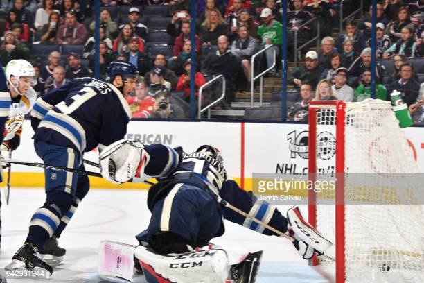 Goaltender Sergei Bobrovsky of the Columbus Blue Jackets reaches back as the puck goes into the net off a tipin shot by Calle Jarnkrok of the...