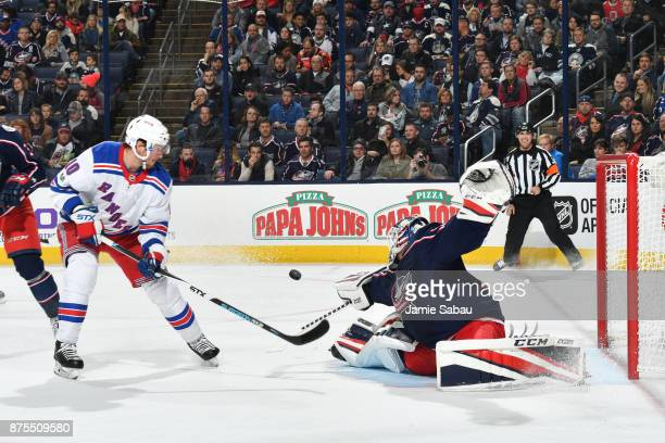 Goaltender Sergei Bobrovsky of the Columbus Blue Jackets redirects a shot taken by Michael Grabner of the New York Rangers during the second period...