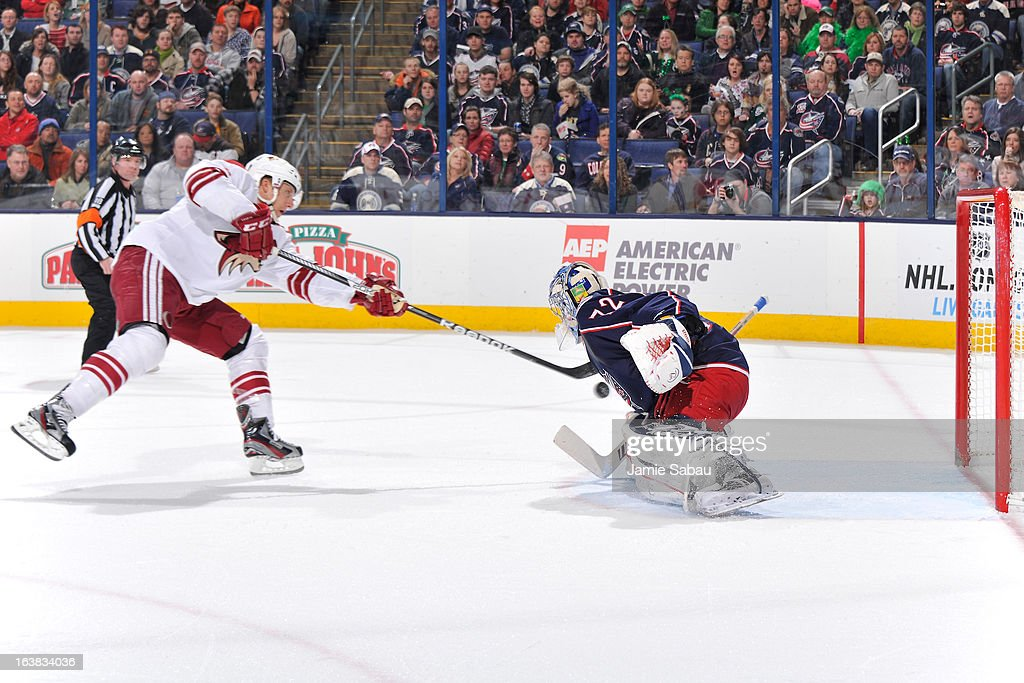 Goaltender Sergei Bobrovsky #72 of the Columbus Blue Jackets stops a break-away shot taken by Rob Klinkhammer #36 of the Phoenix Coyotes during the second period on March 16, 2013 at Nationwide Arena in Columbus, Ohio.