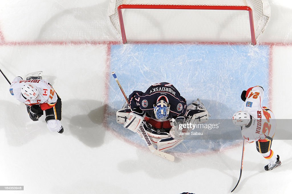Goaltender <a gi-track='captionPersonalityLinkClicked' href=/galleries/search?phrase=Sergei+Bobrovsky&family=editorial&specificpeople=4488556 ng-click='$event.stopPropagation()'>Sergei Bobrovsky</a> #72 of the Columbus Blue Jackets stops a shot from the Calgary Frames on March 22, 2013 at Nationwide Arena in Columbus, Ohio.