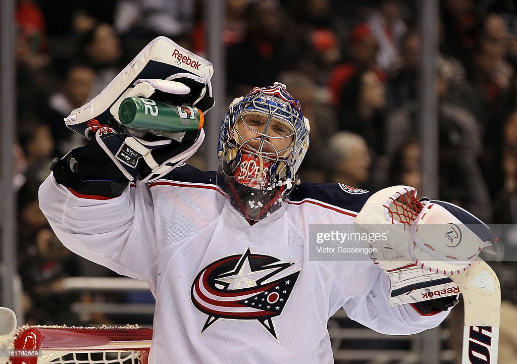 Goaltender <a gi-track='captionPersonalityLinkClicked' href=/galleries/search?phrase=Sergei+Bobrovsky&family=editorial&specificpeople=4488556 ng-click='$event.stopPropagation()'>Sergei Bobrovsky</a> #72 of the Columbus Blue Jackets takes a drink of water during the NHL game against the Los Angeles Kings at Staples Center on February 15, 2013 in Los Angeles, California. The Kings defeated the Blue Jackets 2-1.