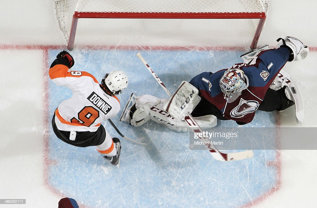 Goaltender Seymon Varlamov #1 of the Colorado Avalanche makes a save against <a gi-track='captionPersonalityLinkClicked' href=/galleries/search?phrase=Steve+Downie&family=editorial&specificpeople=714514 ng-click='$event.stopPropagation()'>Steve Downie</a> #9 of the Philadelphia Flyers at the Pepsi Center on January, 2014 in Denver, Colorado.