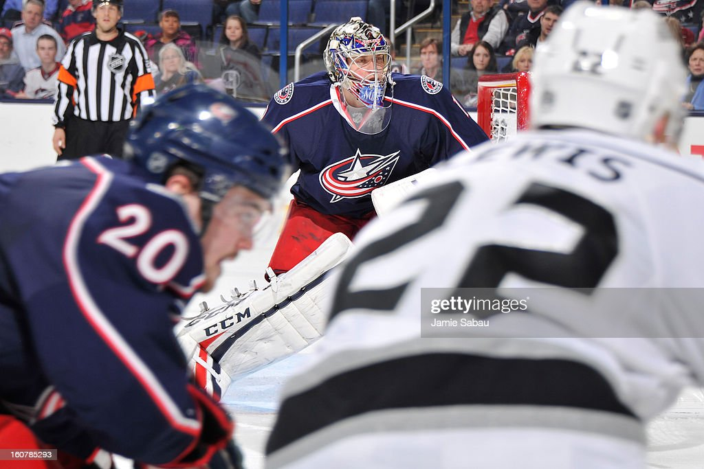 Goaltender Steve Mason #1 of the Columbus Blue Jackets follows the puck in to the corner as <a gi-track='captionPersonalityLinkClicked' href=/galleries/search?phrase=Tim+Erixon+-+Jogador+de+h%C3%B3quei+no+gelo&family=editorial&specificpeople=8546945 ng-click='$event.stopPropagation()'>Tim Erixon</a> #20 of the Columbus Blue Jackets and <a gi-track='captionPersonalityLinkClicked' href=/galleries/search?phrase=Trevor+Lewis&family=editorial&specificpeople=543187 ng-click='$event.stopPropagation()'>Trevor Lewis</a> #22 of the Los Angeles Kings chase after the puck in the second period on February 5, 2013 at Nationwide Arena in Columbus, Ohio. Los Angeles defeated Columbus 4-2.