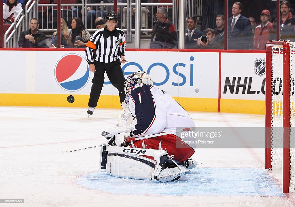 Goaltender Steve Mason #1 of the Columbus Blue Jackets makes a save during the NHL game against the Phoenix Coyotes at Jobing.com Arena on January 23, 2013 in Glendale, Arizona. The Coyotes defeated the Blue Jackets 5-1.