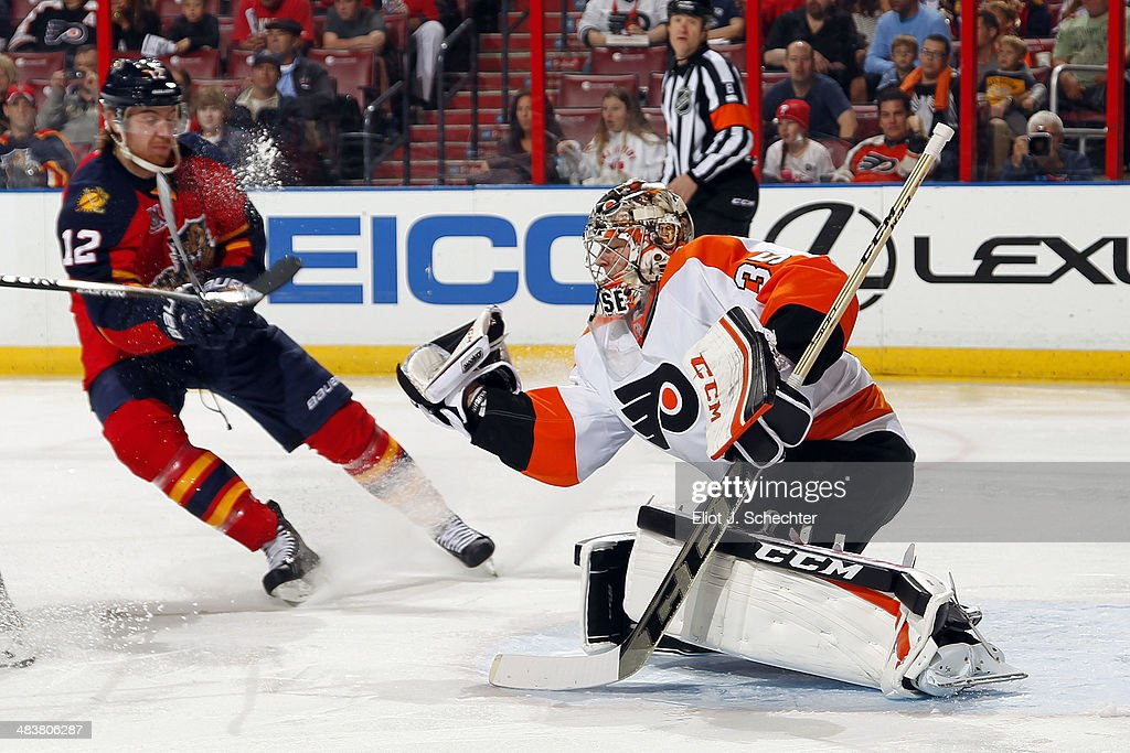 Goaltender Steve Mason #35 of the Philadelphia Flyers defends the net against Jimmy Hayes #12 of the Florida Panthers at the BB&T Center on April 8, 2014 in Sunrise, Florida.