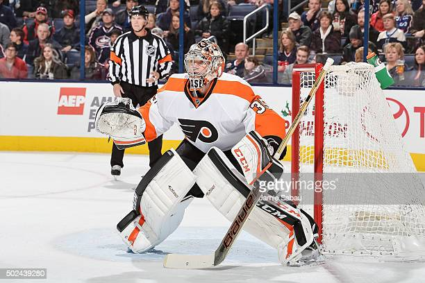 Goaltender Steve Mason of the Philadelphia Flyers defends the net against the Columbus Blue Jackets on December 19 2015 at Nationwide Arena in...