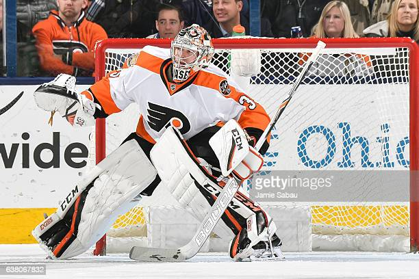Goaltender Steve Mason of the Philadelphia Flyers defends the net against the Columbus Blue Jackets on January 8 2017 at Nationwide Arena in Columbus...