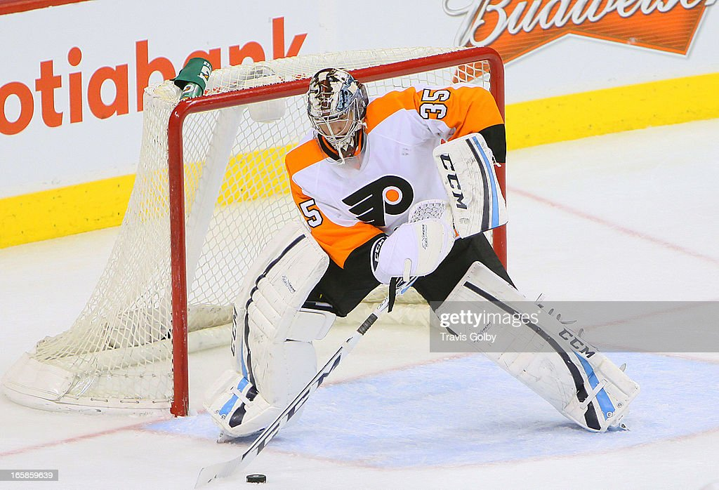 Goaltender Steve Mason #35 of the Philadelphia Flyers gets set to play the puck during third period action against the Winnipeg Jets at the MTS Centre on April 6, 2013 in Winnipeg, Manitoba, Canada.
