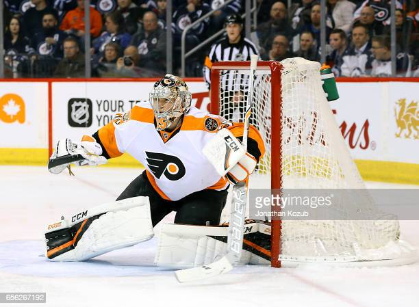 Goaltender Steve Mason of the Philadelphia Flyers guards the net during first period action against the Winnipeg Jets at the MTS Centre on March 21...