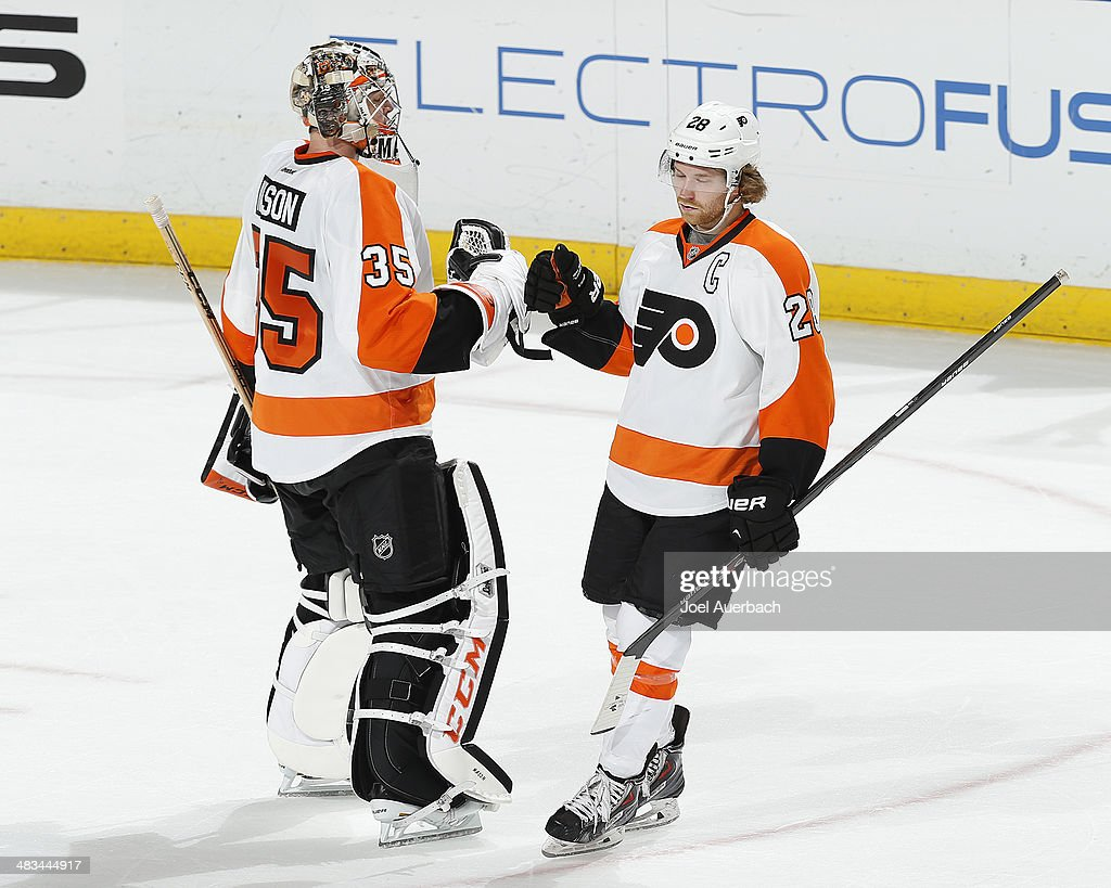 Goaltender Steve Mason #35 of the Philadelphia Flyers is congratulated by <a gi-track='captionPersonalityLinkClicked' href=/galleries/search?phrase=Claude+Giroux&family=editorial&specificpeople=537961 ng-click='$event.stopPropagation()'>Claude Giroux</a> #28 after the victory over the Florida Panthers at the BB&T Center on April 8, 2014 in Sunrise, Florida. The Flyers defeated the Panthers 5-2.
