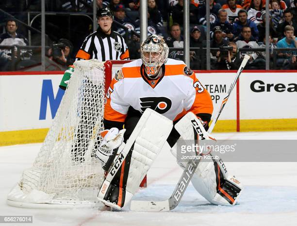 Goaltender Steve Mason of the Philadelphia Flyers keeps an eye on the play during second period action against the Winnipeg Jets at the MTS Centre on...