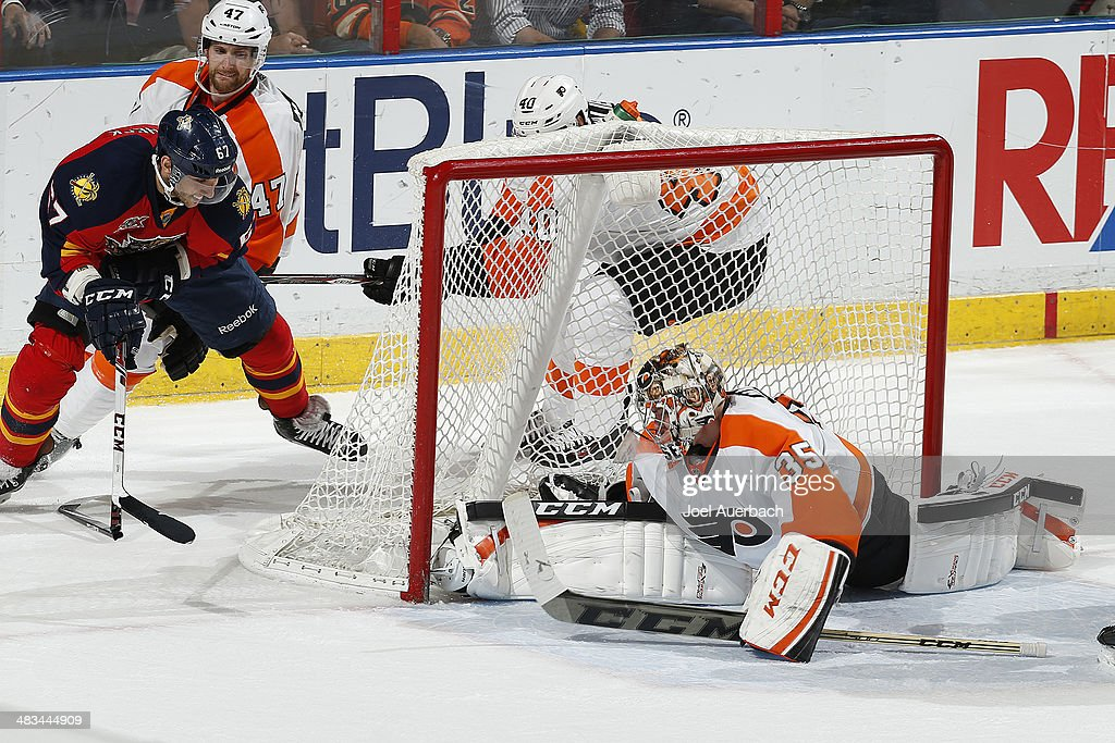 Goaltender Steve Mason #35 of the Philadelphia Flyers stops the shot by Vincent Trocheck #67 of the Florida Panthers as he breaks his stick on the wrap around attempt at the BB&T Center on April 8, 2014 in Sunrise, Florida. The Flyers defeated the Panthers 5-2.
