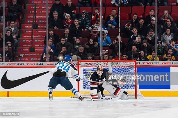 Goaltender Thatcher Demko of Team United States stops Kasperi Kapanen of Team Finland in a shootout during the 2015 IIHF World Junior Hockey...