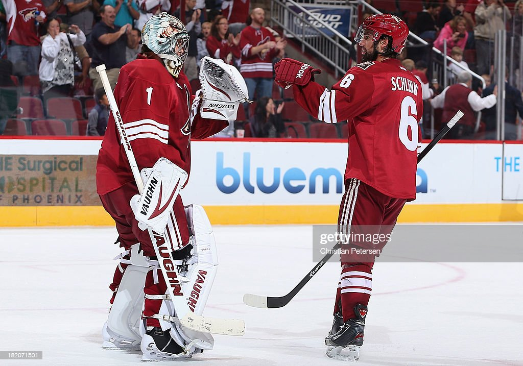 Goaltender Thomas Greiss #1 and David Schlemko #6 of the Phoenix Coyotes celebrate after defeating the San Jose Sharks 2-1 in the preseason NHL game at Jobing.com Arena on September 27, 2013 in Glendale, Arizona.