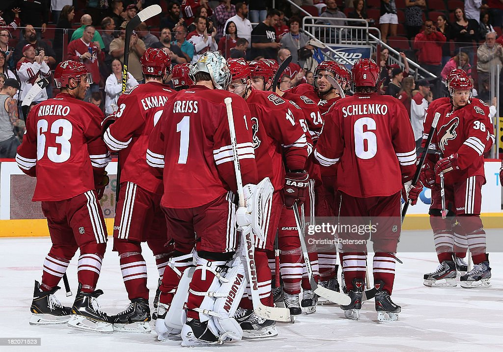Goaltender Thomas Greiss #1 and Radim Vrbata #17 of the Phoenix Coyotes celebrate after defeating the San Jose Sharks 2-1 in the preseason NHL game at Jobing.com Arena on September 27, 2013 in Glendale, Arizona.