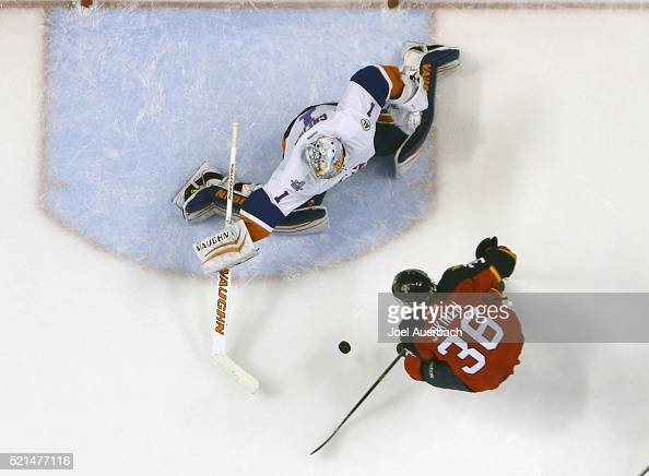 Goaltender Thomas Greiss of the New York Islanders stops a shot by Jussi Jokinen of the Florida Panthers in Game Two of the Eastern Conference...