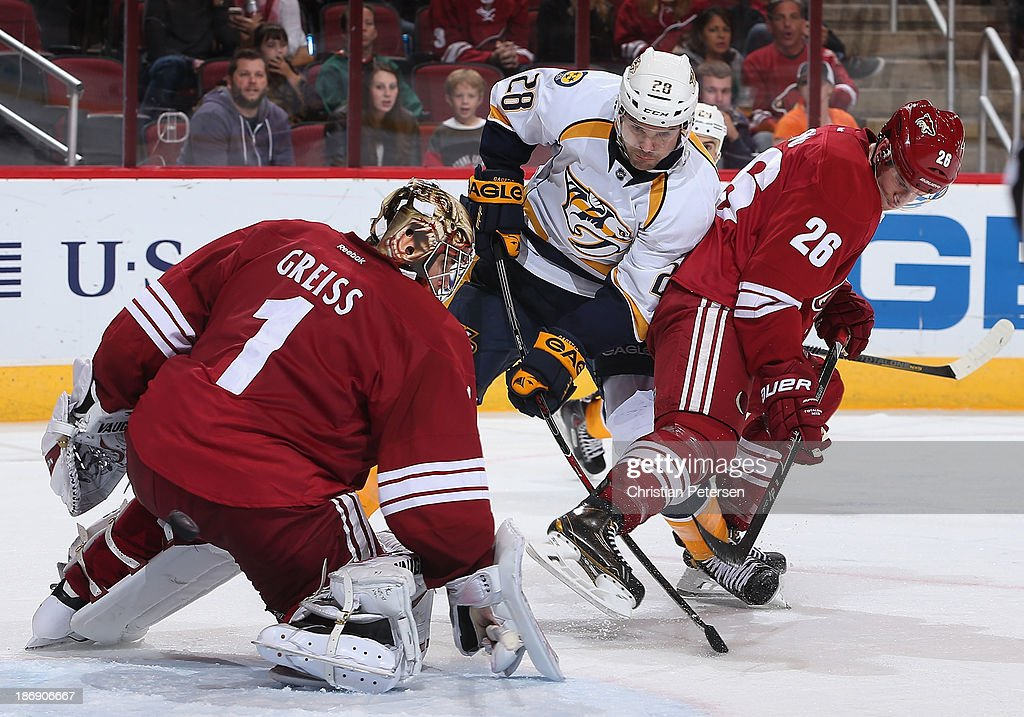 Goaltender <a gi-track='captionPersonalityLinkClicked' href=/galleries/search?phrase=Thomas+Greiss&family=editorial&specificpeople=695275 ng-click='$event.stopPropagation()'>Thomas Greiss</a> #1 of the Phoenix Coyotes blocks a shot from <a gi-track='captionPersonalityLinkClicked' href=/galleries/search?phrase=Paul+Gaustad&family=editorial&specificpeople=577980 ng-click='$event.stopPropagation()'>Paul Gaustad</a> #28 of the Nashville Predators defended by Michael Stone #26 during the NHL game at Jobing.com Arena on October 31, 2013 in Glendale, Arizona. The Coyotes defeated the Predators 5-4 in an overtime shoot out.