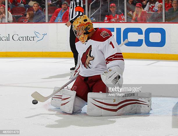 Goaltender Thomas Greiss of the Phoenix Coyotes makes a save against the New Jersey Devils during the game at the Prudential Center on March 27 2014...