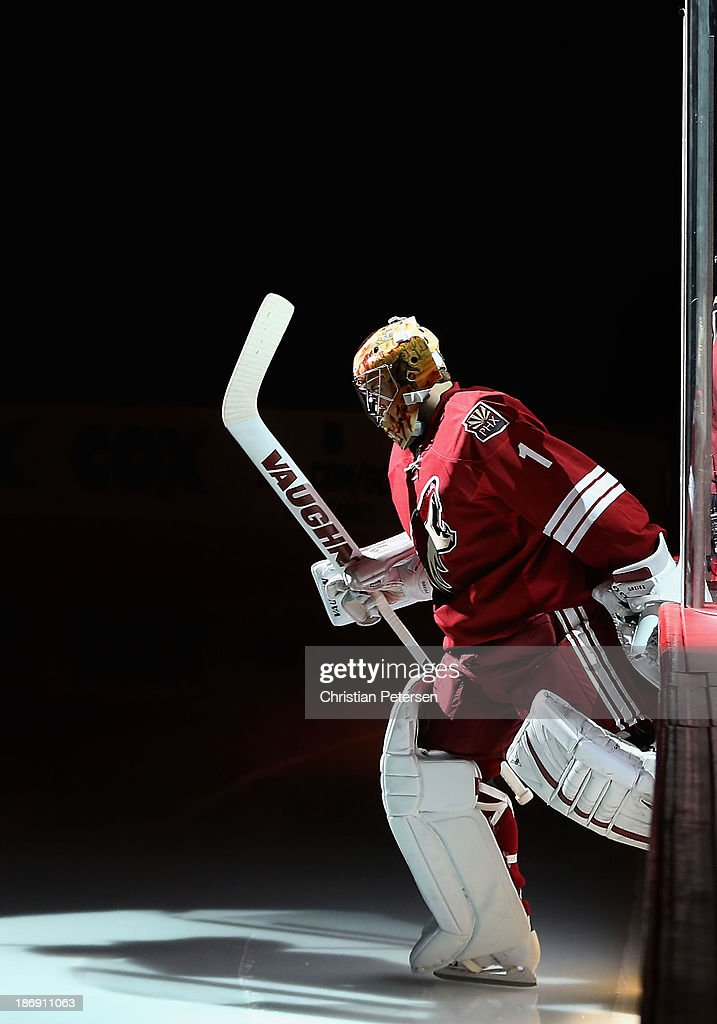 Goaltender <a gi-track='captionPersonalityLinkClicked' href=/galleries/search?phrase=Thomas+Greiss&family=editorial&specificpeople=695275 ng-click='$event.stopPropagation()'>Thomas Greiss</a> #1 of the Phoenix Coyotes skates out onto the ice before the NHL game against the Nashville Predators at Jobing.com Arena on October 31, 2013 in Glendale, Arizona. The Coyotes defeated the Predators 5-4 in an overtime shoot out.