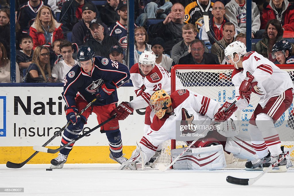 Goaltender <a gi-track='captionPersonalityLinkClicked' href=/galleries/search?phrase=Thomas+Greiss&family=editorial&specificpeople=695275 ng-click='$event.stopPropagation()'>Thomas Greiss</a> #1 <a gi-track='captionPersonalityLinkClicked' href=/galleries/search?phrase=Oliver+Ekman-Larsson&family=editorial&specificpeople=5894618 ng-click='$event.stopPropagation()'>Oliver Ekman-Larsson</a> #23 of the Phoenix Coyotes defends the net against <a gi-track='captionPersonalityLinkClicked' href=/galleries/search?phrase=Corey+Tropp&family=editorial&specificpeople=5483748 ng-click='$event.stopPropagation()'>Corey Tropp</a> #26 of the Columbus Blue Jackets during the second period on April 8, 2014 at Nationwide Arena in Columbus, Ohio.