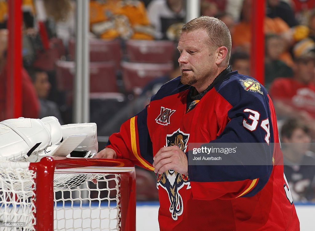 Goaltender Tim Thomas #34 of the Florida Panthers adjusts his equipment during a break in action against the Boston Bruins at the BB&T Center on October 17, 2013 in Sunrise, Florida. Thomas led the Bruins to the Stanley Cup Championship in 2011 and is facing his former team for the first time. The Bruins defeated the Panthers 3-2.