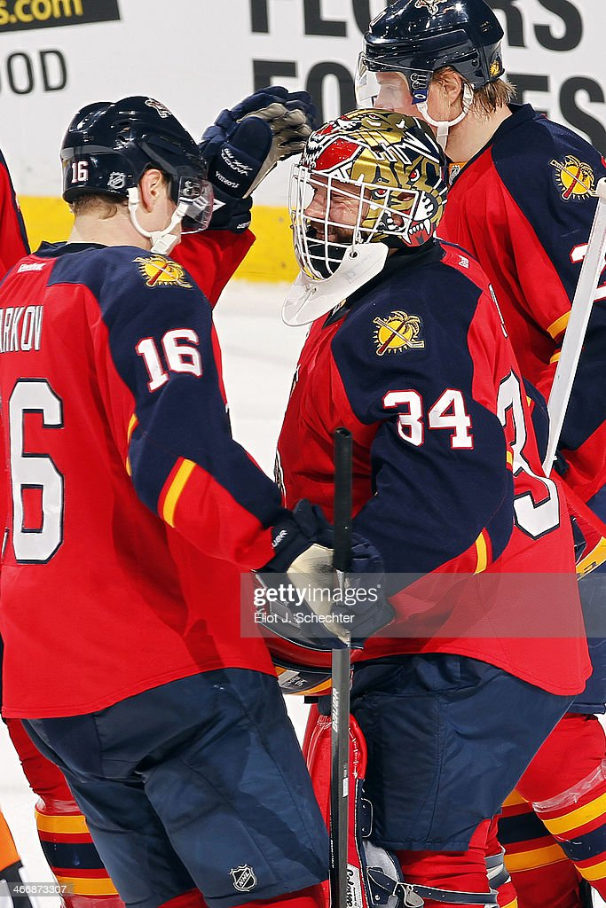 Goaltender Tim Thomas #34 of the Florida Panthers celebrates a 4-1 win with teammate <a gi-track='captionPersonalityLinkClicked' href=/galleries/search?phrase=Aleksander+Barkov&family=editorial&specificpeople=8760147 ng-click='$event.stopPropagation()'>Aleksander Barkov</a> #16 against the Toronto Maple Leafs at the BB&T Center on February 4, 2014 in Sunrise, Florida.