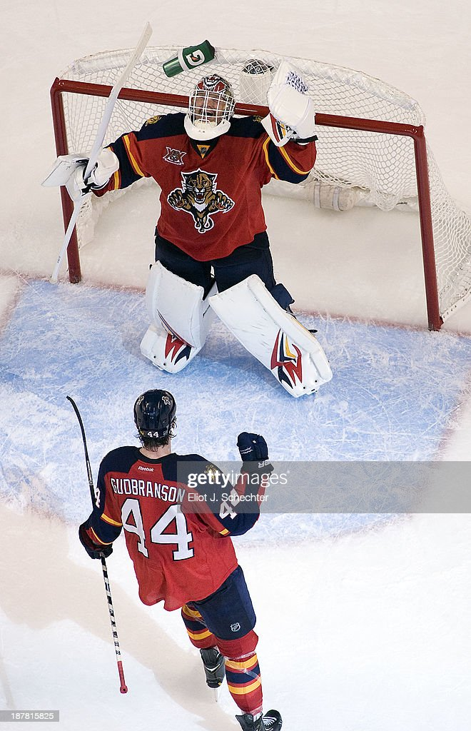 Goaltender Tim Thomas #34 of the Florida Panthers celebrates their 3-2 win with teammate <a gi-track='captionPersonalityLinkClicked' href=/galleries/search?phrase=Erik+Gudbranson&family=editorial&specificpeople=5741800 ng-click='$event.stopPropagation()'>Erik Gudbranson</a> #44 against the Anaheim Ducks at the BB&T Center on November 12, 2013 in Sunrise, Florida.