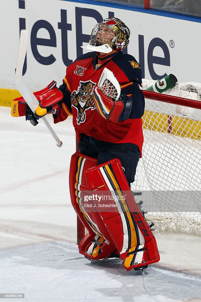 Goaltender Tim Thomas #34 of the Florida Panthers celebrates their 5-2 win against the Winnipeg Jets at the BB&T Center on December 5, 2013 in Sunrise, Florida.