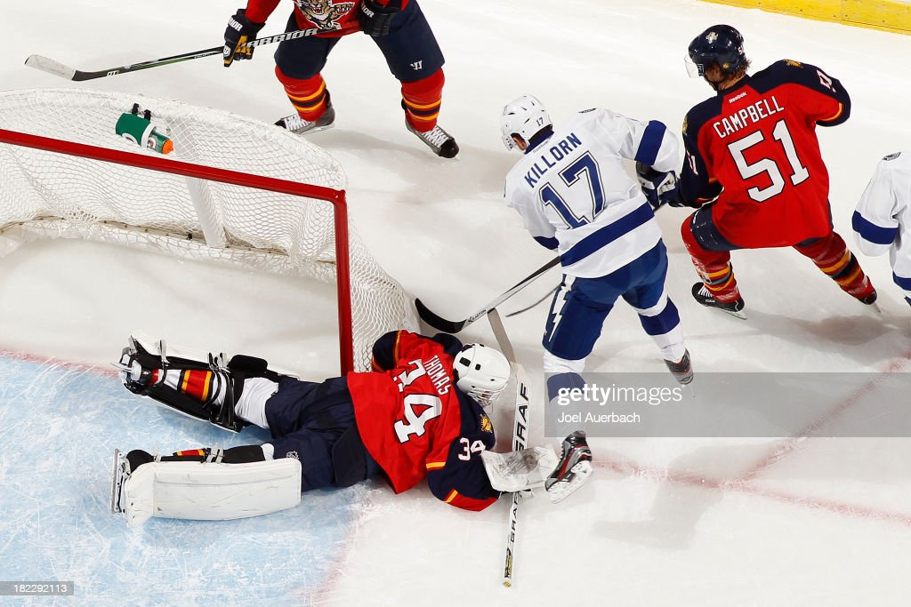 Goaltender Tim Thomas #34 of the Florida Panthers covers the puck as Alex Killorn #17 of the Tampa Bay Lightning looks for a possible rebound attempt at the BB&T Center on September 28, 2013 in Sunrise, Florida. The Panthers defeated the Lightning 5-3.