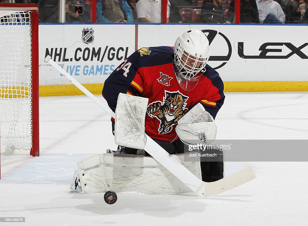 Goaltender Tim Thomas #34 of the Florida Panthers defends the net against the Minnesota Wild at the BB&T Center on October 19, 2013 in Sunrise, Florida. The Panthers defeated the Wild 2-1 in a shoot-out.