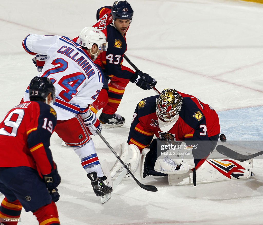 Goaltender Tim Thomas #34 of the Florida Panthers defends the net against <a gi-track='captionPersonalityLinkClicked' href=/galleries/search?phrase=Ryan+Callahan&family=editorial&specificpeople=809690 ng-click='$event.stopPropagation()'>Ryan Callahan</a> #24 of the New York Rangers at the BB&T Center on November 27, 2013 in Sunrise, Florida.