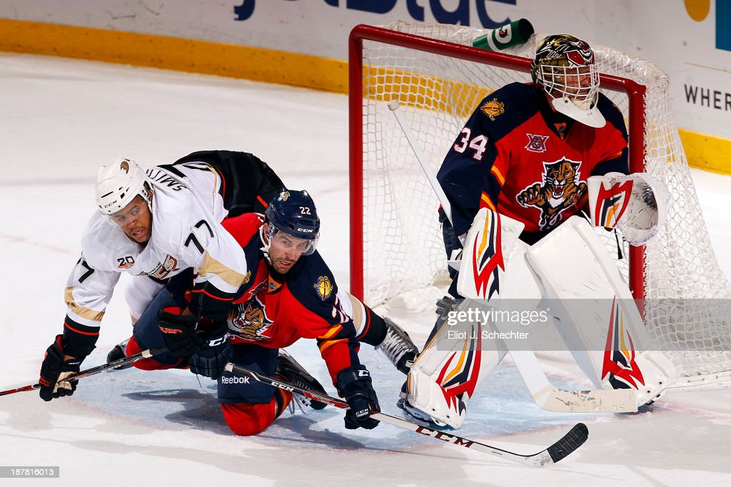 Goaltender Tim Thomas #34 of the Florida Panthers defends the net while teammate <a gi-track='captionPersonalityLinkClicked' href=/galleries/search?phrase=Mike+Mottau&family=editorial&specificpeople=848917 ng-click='$event.stopPropagation()'>Mike Mottau</a> #22 tangles with <a gi-track='captionPersonalityLinkClicked' href=/galleries/search?phrase=Devante+Smith-Pelly&family=editorial&specificpeople=6340107 ng-click='$event.stopPropagation()'>Devante Smith-Pelly</a> #77 of the Anaheim Ducks at the BB&T Center on November 12, 2013 in Sunrise, Florida.