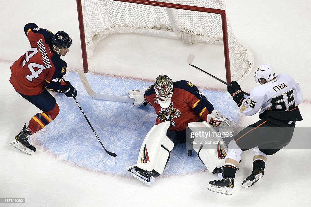 Goaltender Tim Thomas #34 of the Florida Panthers defends the net with the help of teammate <a gi-track='captionPersonalityLinkClicked' href=/galleries/search?phrase=Erik+Gudbranson&family=editorial&specificpeople=5741800 ng-click='$event.stopPropagation()'>Erik Gudbranson</a> #44 against <a gi-track='captionPersonalityLinkClicked' href=/galleries/search?phrase=Emerson+Etem&family=editorial&specificpeople=6365314 ng-click='$event.stopPropagation()'>Emerson Etem</a> #65 of the Anaheim Ducks at the BB&T Center on November 12, 2013 in Sunrise, Florida.