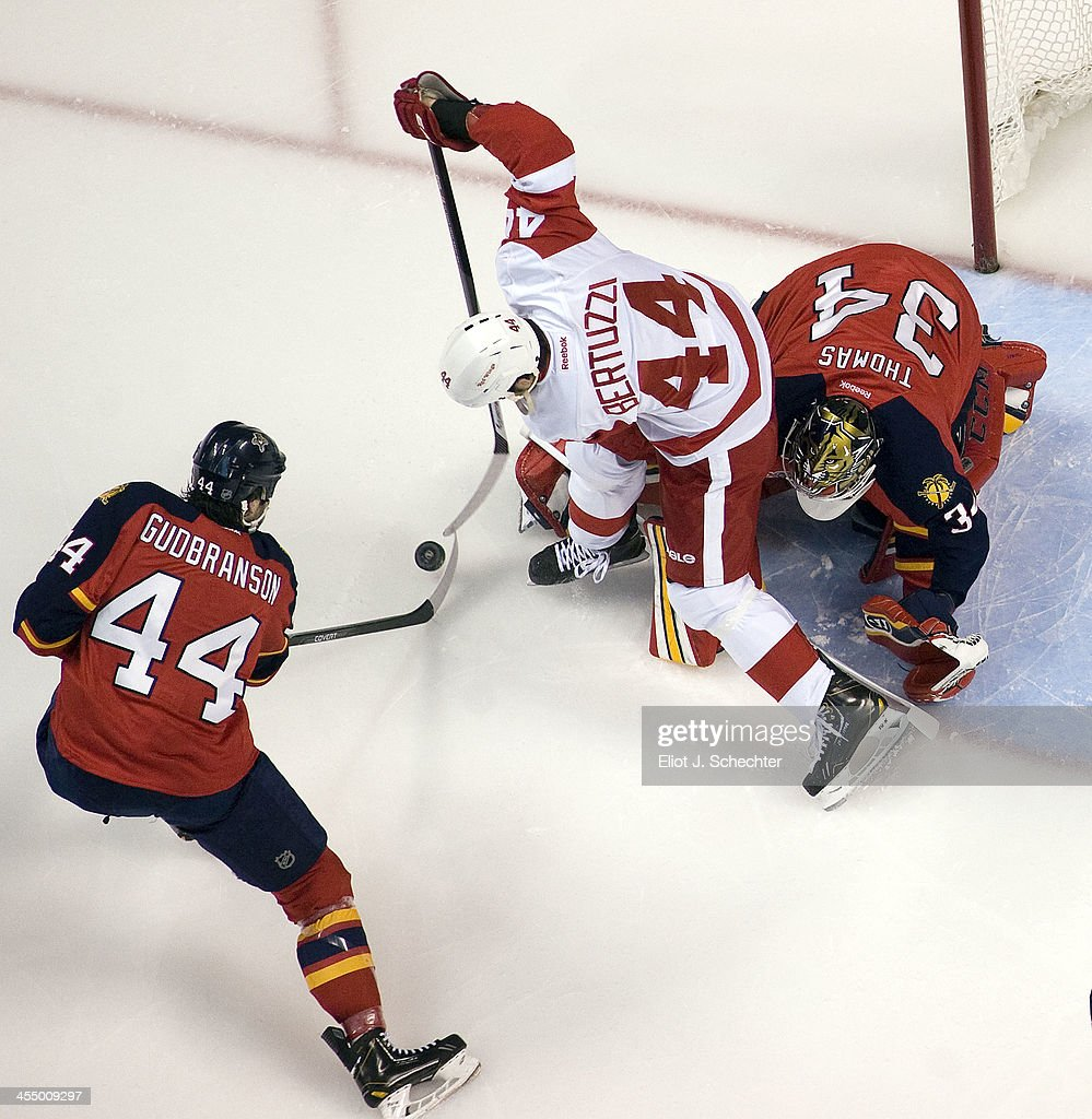 Goaltender Tim Thomas #34 of the Florida Panthers defends the net with the help of <a gi-track='captionPersonalityLinkClicked' href=/galleries/search?phrase=Erik+Gudbranson&family=editorial&specificpeople=5741800 ng-click='$event.stopPropagation()'>Erik Gudbranson</a> #44 against <a gi-track='captionPersonalityLinkClicked' href=/galleries/search?phrase=Todd+Bertuzzi&family=editorial&specificpeople=202476 ng-click='$event.stopPropagation()'>Todd Bertuzzi</a> #44 the Detroit Red Wings at the BB&T Center on December 10, 2013 in Sunrise, Florida.