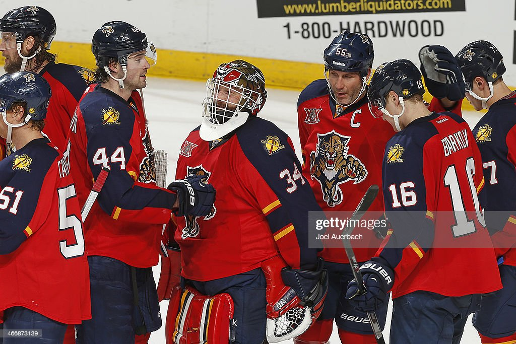Goaltender Tim Thomas #34 of the Florida Panthers is congratulated by teammates after the game against the Toronto Maple Leafs at the BB&T Center on February 4, 2014 in Sunrise, Florida. The Panthers defeated the Maple Leafs 4-1.