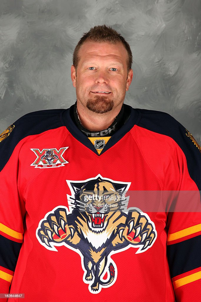 Goaltender Tim Thomas of the Florida Panthers poses for his official headshot for the 2013-2014 NHL season on October 1, 2013 in Sunrise, Florida.