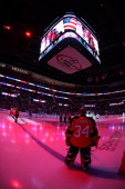 Goaltender Tim Thomas of the Florida Panthers stands on the ice for the national anthem prior to the start of the game against the San Jose Sharks at...