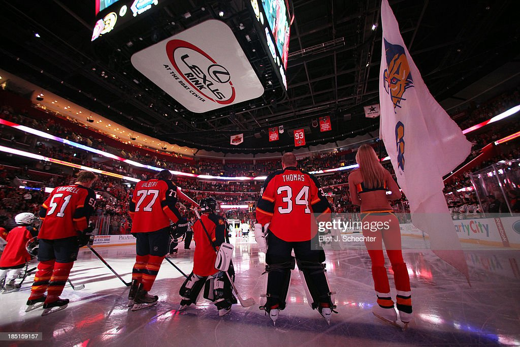 Goaltender Tim Thomas #34 of the Florida Panthers stands on the ice with teammates for the national anthem prior to the start of the game against the Boston Bruins at the BB&T Center on October 17, 2013 in Sunrise, Florida.