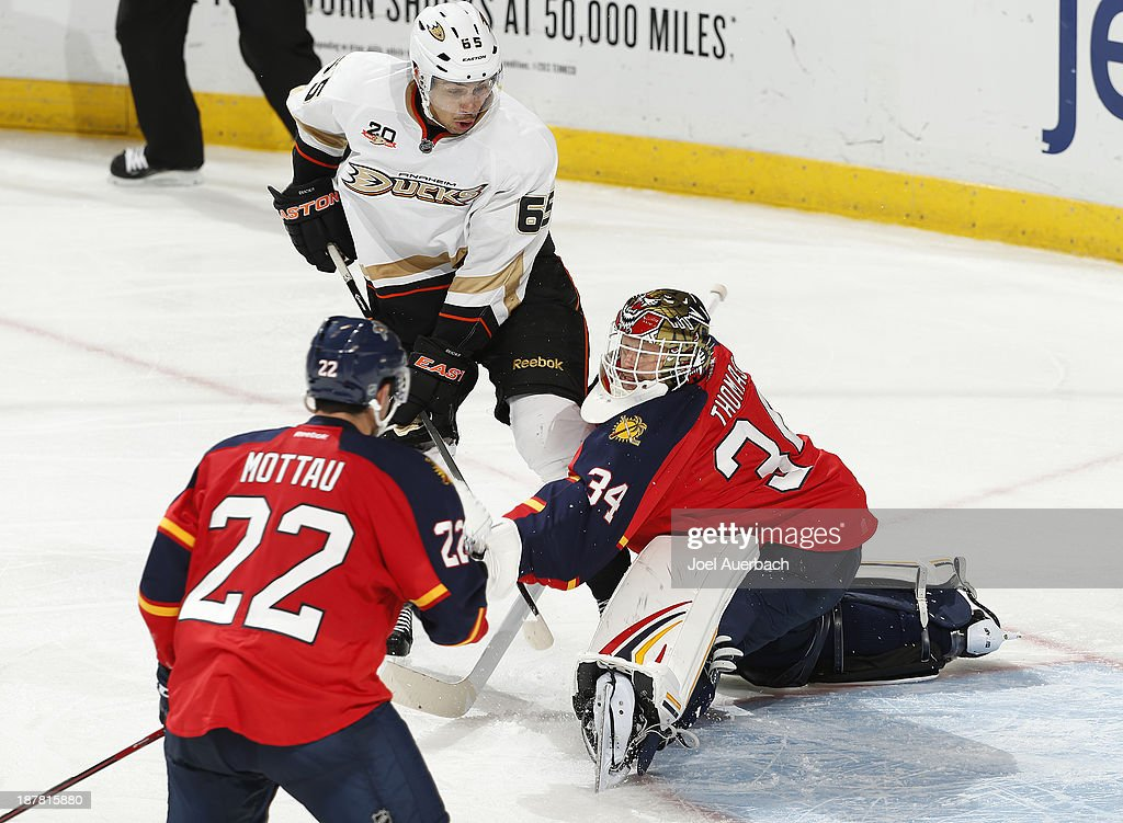 Goaltender Tim Thomas #34 of the Florida Panthers stops a shot by <a gi-track='captionPersonalityLinkClicked' href=/galleries/search?phrase=Emerson+Etem&family=editorial&specificpeople=6365314 ng-click='$event.stopPropagation()'>Emerson Etem</a> #65 of the Anaheim Ducks at the BB&T Center on November 12, 2013 in Sunrise, Florida. The Panthers defeated the Ducks 3-2.