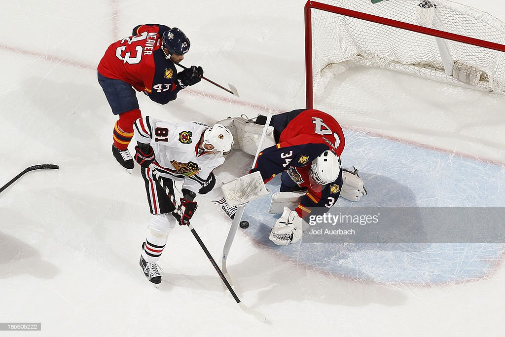 Goaltender Tim Thomas #34 of the Florida Panthers stops a shot by <a gi-track='captionPersonalityLinkClicked' href=/galleries/search?phrase=Marian+Hossa&family=editorial&specificpeople=202233 ng-click='$event.stopPropagation()'>Marian Hossa</a> #81 of the Chicago Blackhawks at the BB&T Center on October 22, 2013 in Sunrise, Florida. The Blackhawks defeated the Panthers 3-2 in a shoot-out.
