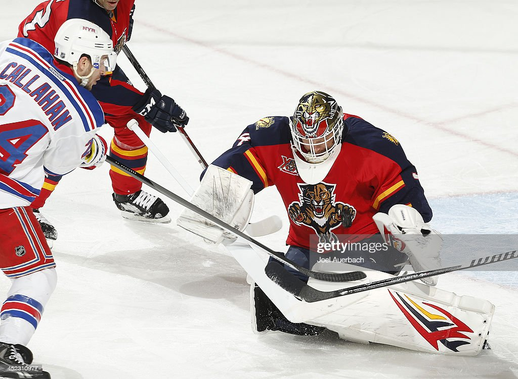 Goaltender Tim Thomas #34 of the Florida Panthers stops a shot by <a gi-track='captionPersonalityLinkClicked' href=/galleries/search?phrase=Ryan+Callahan&family=editorial&specificpeople=809690 ng-click='$event.stopPropagation()'>Ryan Callahan</a> #24 of the New York Rangers at the BB&T Center on November 27, 2013 in Sunrise, Florida. The Rangers defeat the Panthers 5-2.
