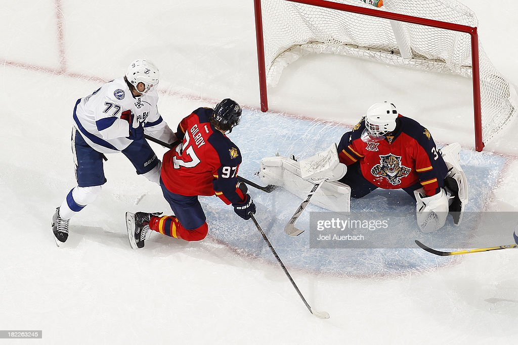 Goaltender Tim Thomas #34 of the Florida Panthers stops a shot by <a gi-track='captionPersonalityLinkClicked' href=/galleries/search?phrase=Victor+Hedman&family=editorial&specificpeople=4784238 ng-click='$event.stopPropagation()'>Victor Hedman</a> #77 of the Tampa Bay Lightning at the BB&T Center on September 28, 2013 in Sunrise, Florida. The Panthers defeated the Lightning 5-3.
