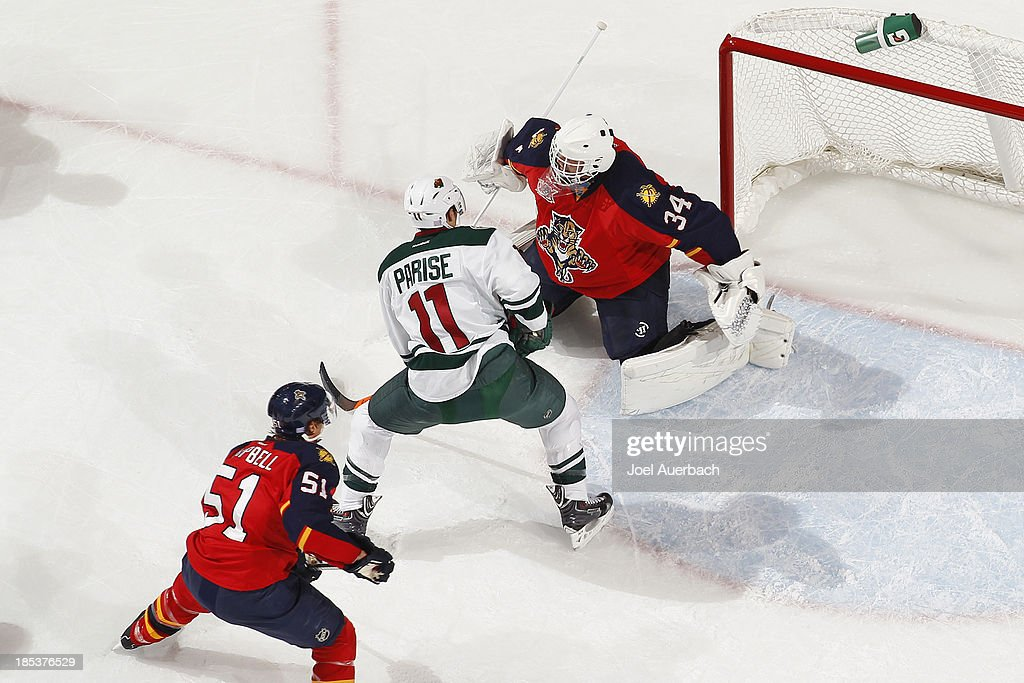 Goaltender Tim Thomas #34 of the Florida Panthers stops a shot by <a gi-track='captionPersonalityLinkClicked' href=/galleries/search?phrase=Zach+Parise&family=editorial&specificpeople=213606 ng-click='$event.stopPropagation()'>Zach Parise</a> #11 of the Minnesota Wild at the BB&T Center on October 19, 2013 in Sunrise, Florida. The Panthers defeated the Wild 2-1 in a shoot-out.