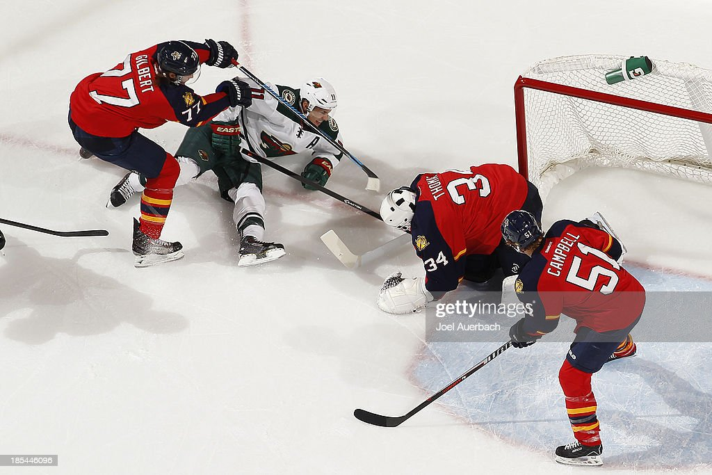 Goaltender Tim Thomas #34 of the Florida Panthers stops a shot by Zach Parise #11 of the Minnesota Wild at the BB&T Center on October 19, 2013 in Sunrise, Florida. The Panthers defeated the Wild 2-1 in a shoot-out.